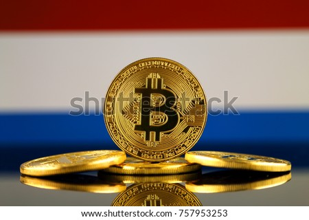 Physical version of Bitcoin (new virtual money) and Netherlands Flag. Conceptual image for investors in cryptocurrency and Blockchain Technology in Netherlands.