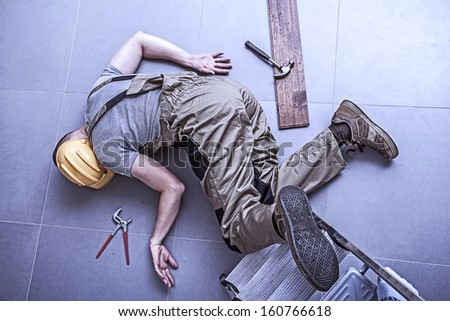 Physical worker injured while working on height - stock photo