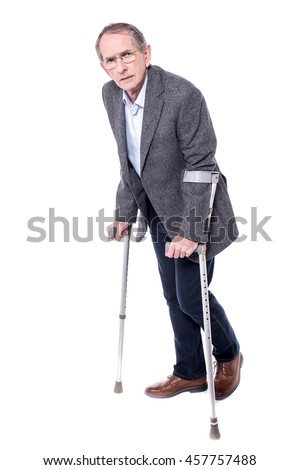 Physically challenged aged man walking