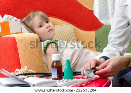 physician house call. Examines sick little girl - stock photo