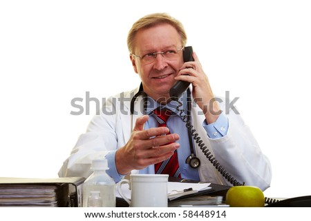 Physician sitting at a desk and talking on the phone