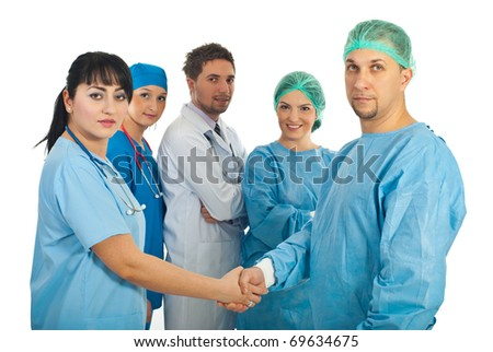 Physician woman and surgeon man handshake and their team of doctors standing with hands crossed in the middle of them isolated on white background