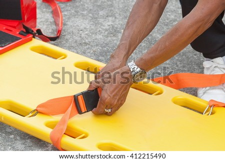 physician yellow stretcher readiness medical equipment. assist patient in emergency rescue situations.(select focus front hand physician and soft-focus background) - stock photo