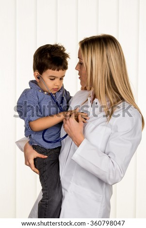 physicians and little boy