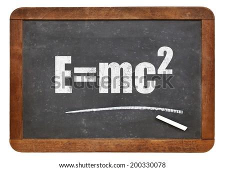 physics education concept - Einstein equation on a small slate blackboard - stock photo
