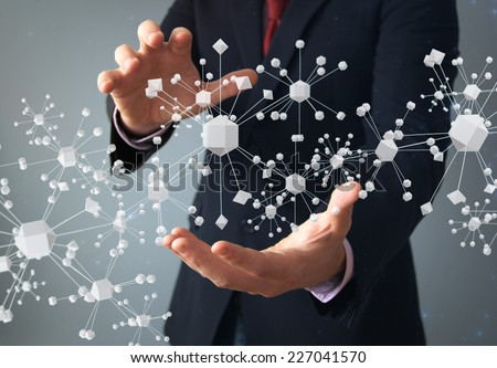physics or connection concept: businessman with molecular structure on hands - stock photo