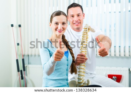 Physiotherapist and patient in a practise after a successfully treatment is the diagnosis a clear improvement, thumbs up - stock photo