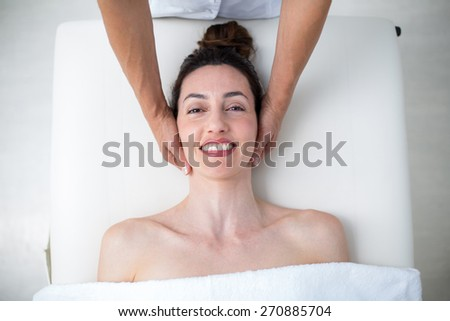 Physiotherapist doing neck massage in medical office - stock photo