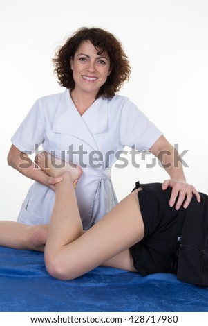 Physiotherapist female doing exercise for legs and knee - stock photo