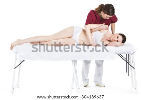 physiotherapist gives mobilisation of a shoulder to patient