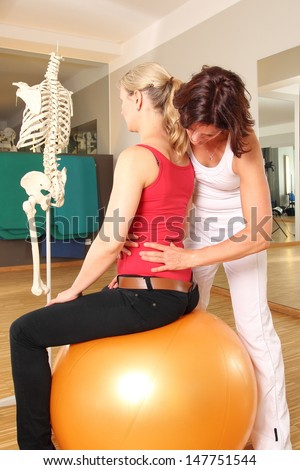 Physiotherapist with patient working on her Lumbar Spine - stock photo