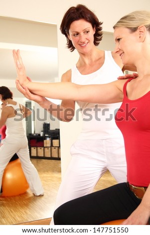Physiotherapist working on arm shoulder nack pain - stock photo