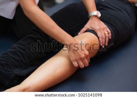 Physiotherapist working with patient in clinic, closeup