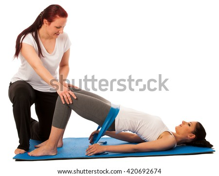 Physiotherapy - therapist doing   exercises with band for improving back strength and stability with a patient to recover  after injury isolated - stock photo