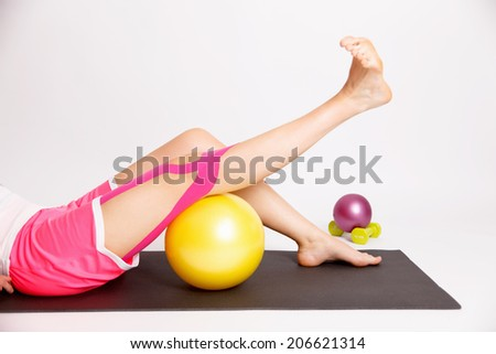 Physiotherapy treatment for kinesio taped knee - stock photo