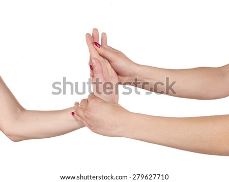 Physiotherapy treatment for wrist pain, aches and tension. It  is also used for prevention and treatment in competitive sports.  - stock photo