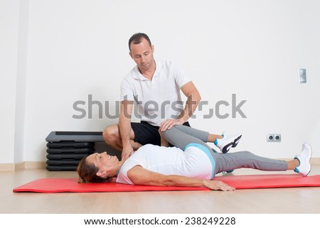 physiotherapy with an elder female patient - stock photo