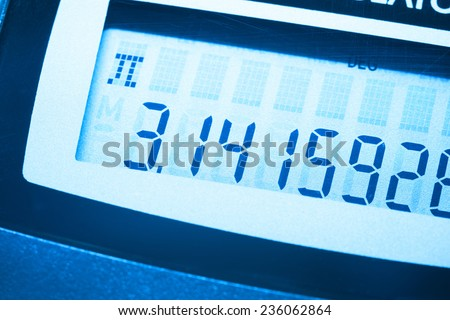 Pi number on the screen of digital calculator - stock photo