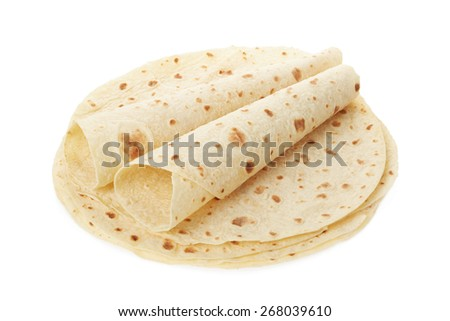 Piadina, italian tortilla heap with wraps isolated on white, clipping path included - stock photo