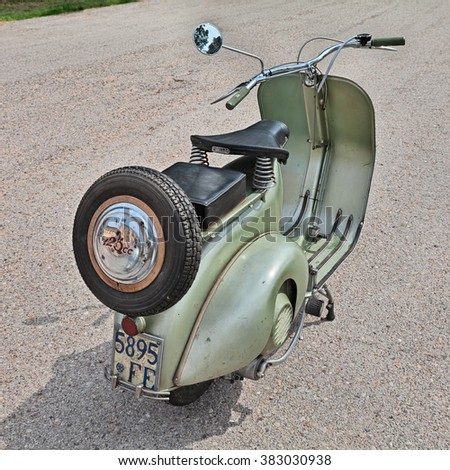 "PIANGIPANE, RA, ITALY - APRIL 25: vintage Italian scooter Vespa 125 (1950) in classic car and motorcycle rally ""15' auto moto raduno"" on April 25, 2015 in Piangipane, RA, Italy"