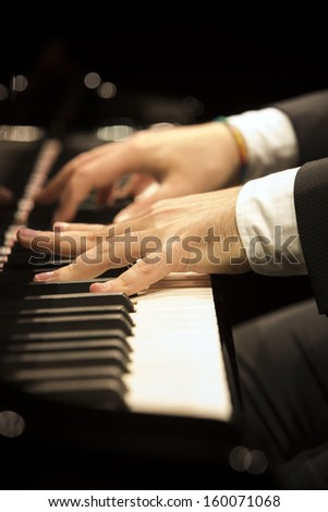 Pianist playing on piano