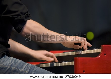 Pianists hands over the keyboard - stock photo