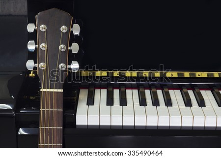 Piano and Acoustic Guitar - stock photo