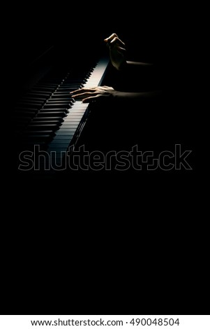 Piano hands pianist playing concert. Grand piano player close up. Musical instrument isolated on black