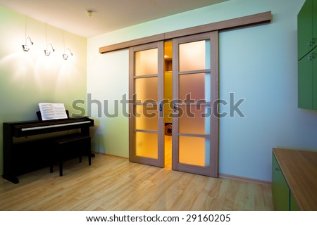 Piano in modern room interior - stock photo