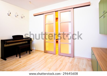 Piano in modern room interior - stock photo