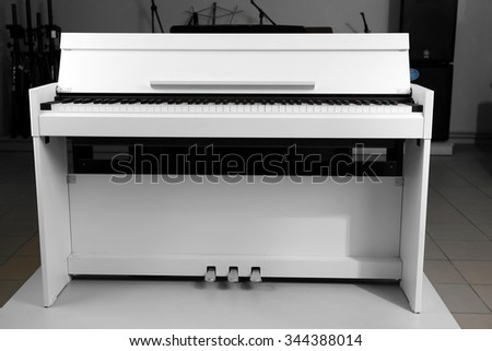 Piano in musical store - stock photo