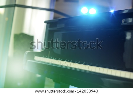 Piano in stage light. - stock photo