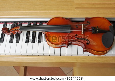 Piano keyboard and violin