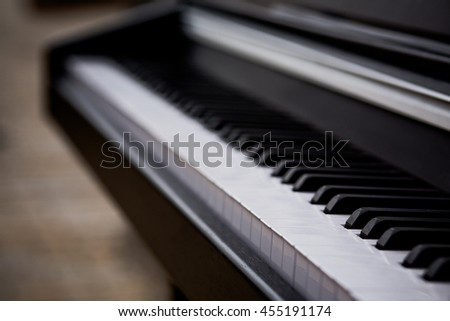 Piano keyboard background with selective focus. Closeup of piano keys. Close frontal view. - stock photo