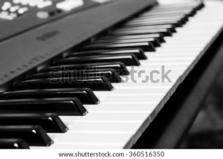 Piano keyboard. Music instrument. Black and white key. Play sound, chord, melody. Classical, musical art. Jazz performance, entertainment. Musician background. Classic note harmony. - stock photo