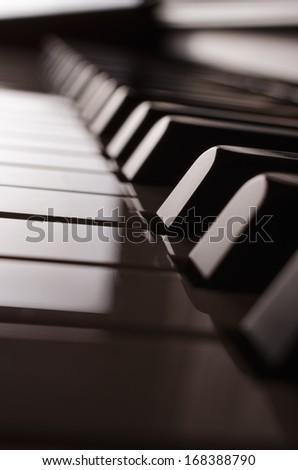 Piano keyboard side view sepia  - stock photo