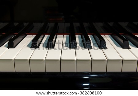 piano keys and notes on stage - stock photo