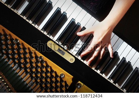 Piano keys pianist hands playing music. Musical instrument grand piano keyboard details - stock photo