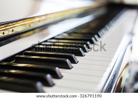 Piano keys ,side view of instrument musical tool. - stock photo