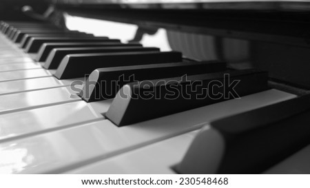 Piano keys side view with shallow depth of field