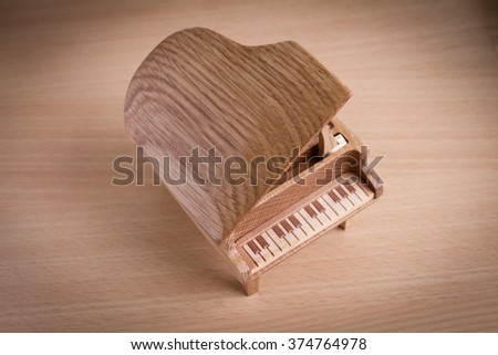 piano music box on wooden background - stock photo