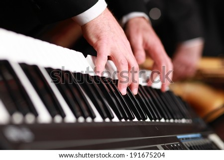Piano player - stock photo