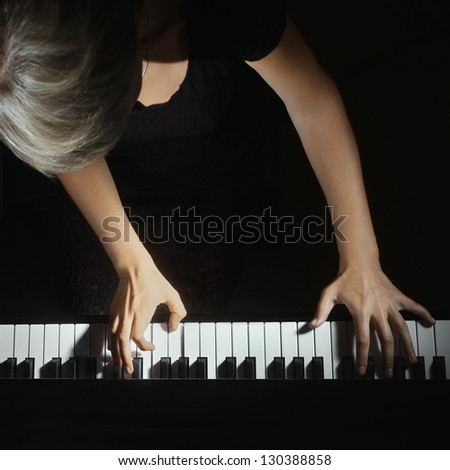 Piano playing pianist player. Woman with musical instrument closeup - stock photo