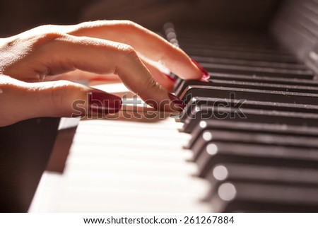 Piano with players hands - stock photo