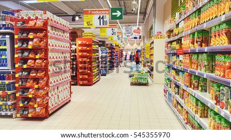 PIATRA NEAMT, ROMANIA - DECMBER 12, 2016: Shopping in Carrefour supermarket aisle with drinks and snacks, Piatra Neamt city of Romania