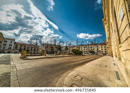 Piazza d'Italia in Sassari under a cloudy sky, Italy