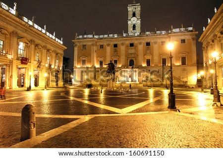 Piazza del Campidoglio, on the top of Capitoline Hill, with the facade of Palazzo Senatorio and the replica of the equestrian statue of Marcus Aurelius. - stock photo