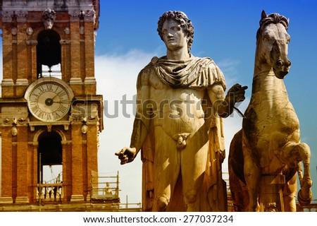 Piazza del Campidoglio - Statue of Pollux at the Cordonata stairs in Rome, Italy - stock photo