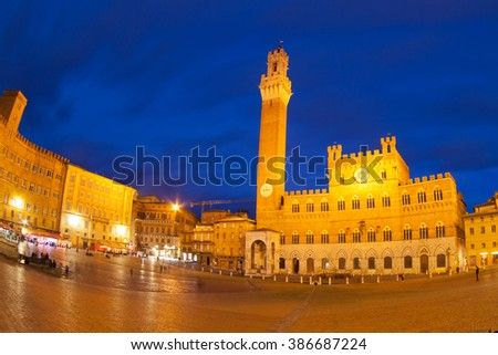 Piazza del Campo with Palazzo Pubblico at night , Siena, Italy -taken with fisheye lens - stock photo