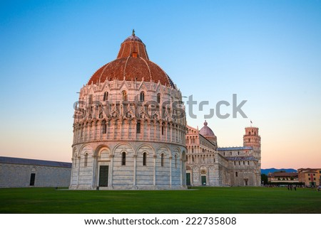 Piazza del Duomo, Battistero, with the Basilica leaning tower  at sunset, Pisa, Italy - stock photo